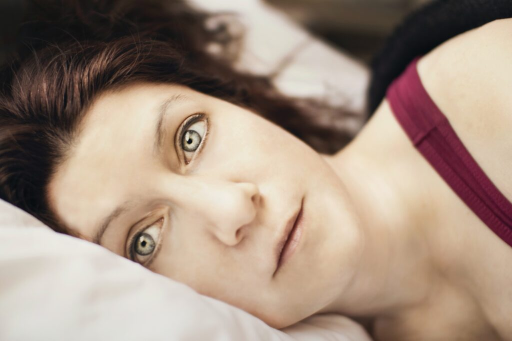 sad woman in bed