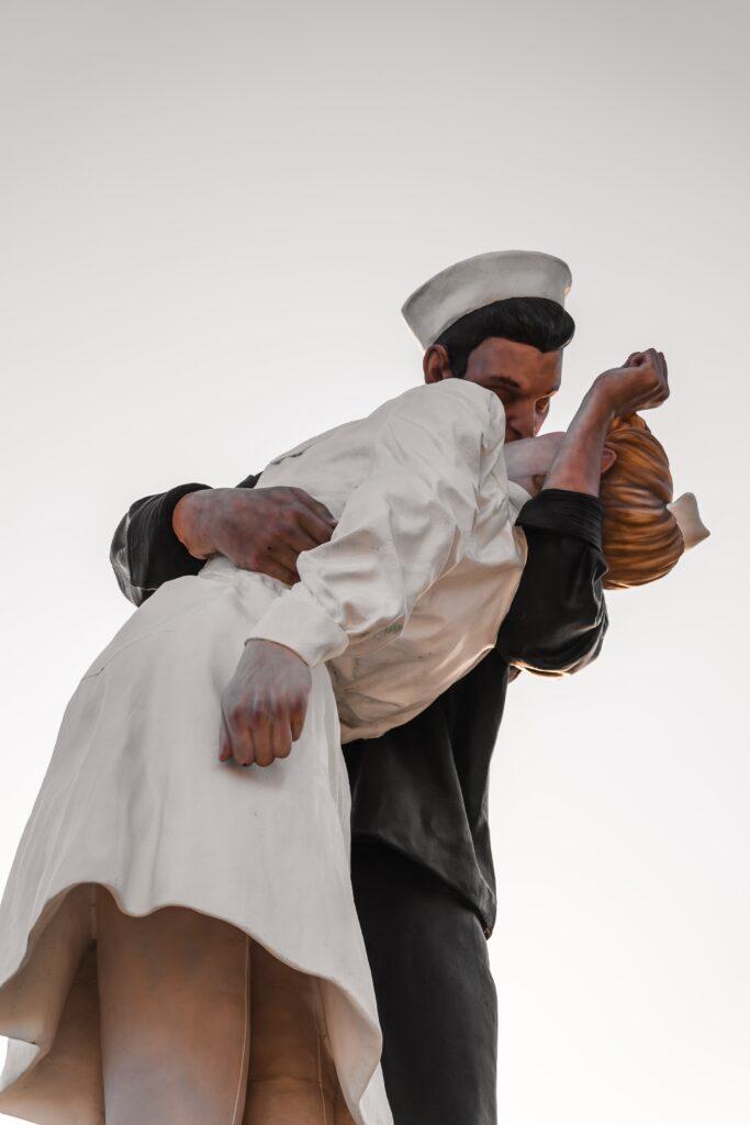 sailor kissing a woman