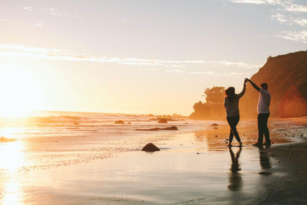 couple on beach dancing
